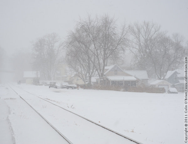 Snow on tracks by lake shore